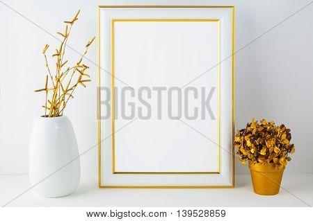 Frame mockup with white vase and golden flower pot. Portrait or poster white frame mockup. Empty white frame mockup for presentation artwork design.
