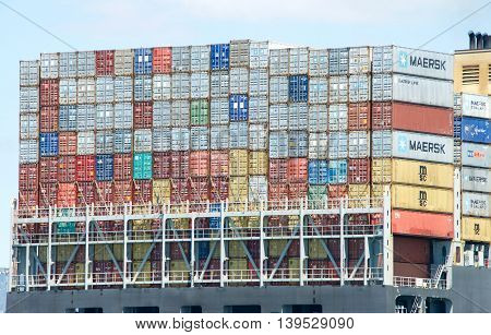 Oakland CA - July 18 2016: Shipping containers are organized and placed algorithmically for efficient transport. Most modern container ships can carry up to 16020 twenty-foot equivalent units.