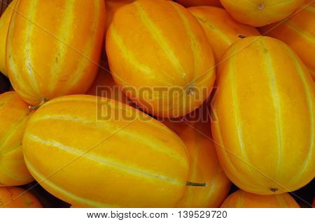 Asian yellow striped oblong melon pattern closeup
