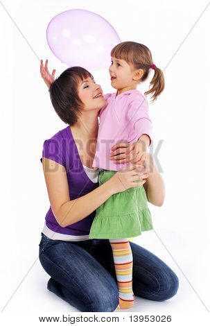 Mother and his two daughters with colorful balloons. studio shoot over white background