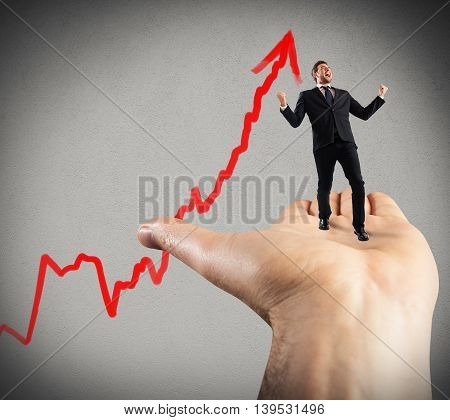 Businessman shouts and exults over a hand
