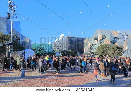 MELBOURNE AUSTRALIA - JULY 16,2016: Unidentified people visit Federation Square in downtown Melbourne.