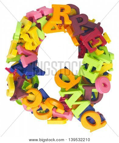 the letter Q  made from a lot of Magnetic letters