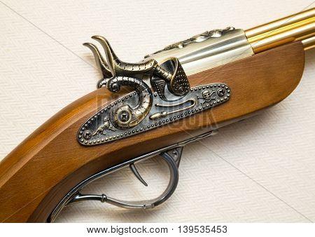 fragment of an old musket pistol flint lock mechanism of the eighteenth century. a copy of the pistol. souvenir poster
