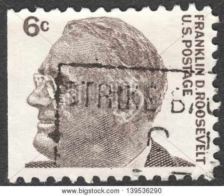 MOSCOW RUSSIA - JANUARY 2016: a post stamp printed in the USA shows a portrait of Franklin D. Roosevelt the 32th President of the USA the series