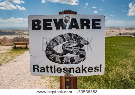BEWARE rattlesnakes warning sign in South Dakota badlands