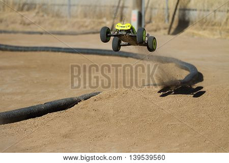 BOISE IDAHO-JULY 16 2016: truggy kicking up dust after taking off the ramp at the Boise Summer Blast points race.