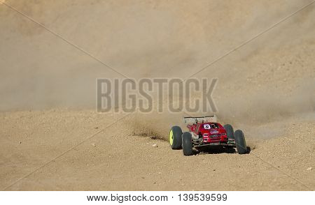 BOISE IDAHO-JULY 16 2016: Long truggy kicking up a lot of dirt power through the straight at the Boise Summer Blase Rc race