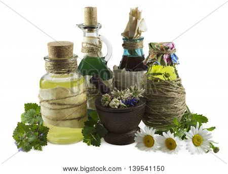 Group of glass bottles with healing herbs, homeopathic still life isolated on white