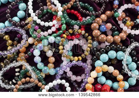 Colorful background with circlets of semiprecious stones