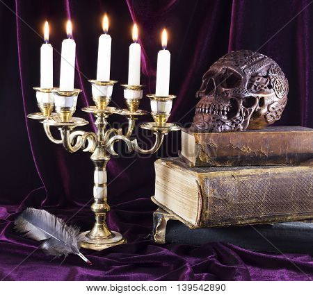 Mystic still life with candelabrum, skull and old book