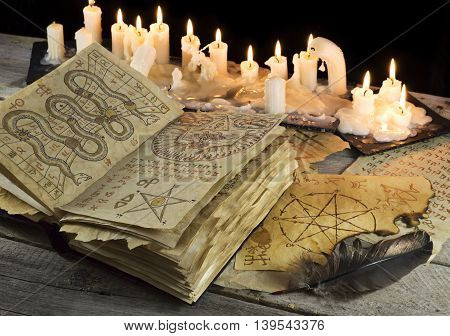 Open Grimoire book with candles and mystic pages, Halloween concept