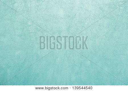 close up at green leather texture background.