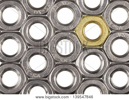 Golden screw nut in steel nuts pattern isolated on white