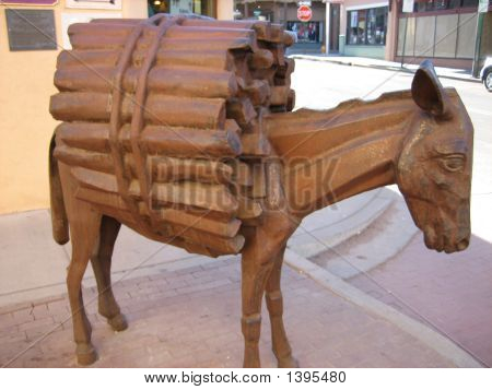 Statue Of Burro Carrying Fire Wood