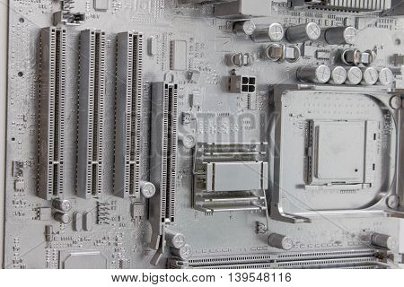 White mother or main board on wall. White electronic circuit main board.