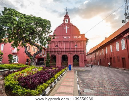 MALACCA MALAYSIA - FEB 29: Malacca Christ Church at Dutch Square historical city centre on Feb 29 2016 in Malacca Malaysia. Malacca was included in the list of UNESCO World Heritage Sites in 2008.