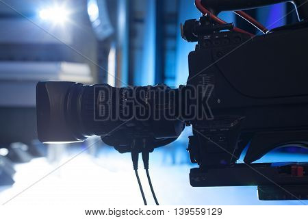 Professional Digital Video Camera. Tv Camera In A Concert Hal.