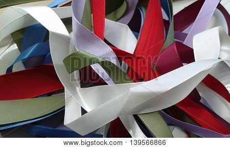 Jumble of ribbons with different widths and colours, satin