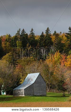 An old weather grey barn in rural Prince Edward Island, Canada.