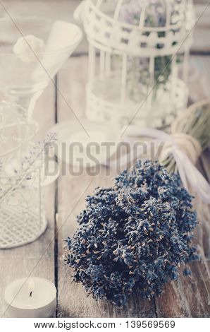 Lavender. Lavender - bunch of lavender flowers on a wooden background. Toned photo