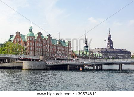waterside scenery including the Christiansborg Palace in Copenhagen the capital city of Denmark