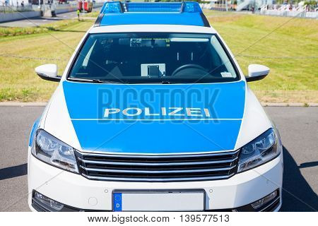 front of a german police car in blue