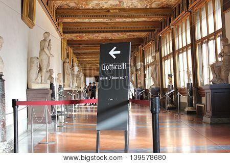 FLORENCE, ITALY - January 20, 2016: pointer to a hall with paintings by Sandro Botticelli, on display at the Uffizi Gallery (Galleria degli Uffizi), Florence, Italy