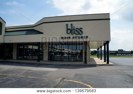 SHOREWOOD, ILLINOIS / UNITED STATES - AUGUST 30, 2015: One may have one's hair cut at the Bliss Hair Studio, in a Shorewood strip mall.