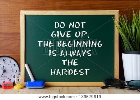 Word Quote Do Not Give Up,the Beginning Is Always The Hardest Written On Green Chalk Board On Wooden