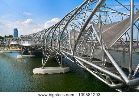 Singapore - August 21: The Helix Bridge On August 21, 2011 In Singapore. Is A Pedestrian Bridge Link