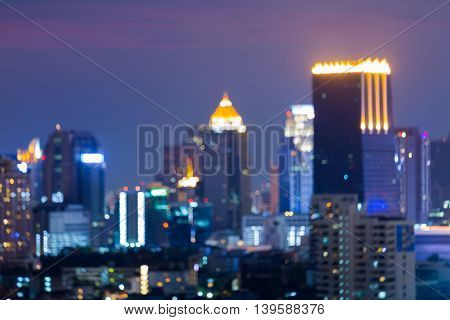 Night blurred lights, city office tower bokeh, abstract background
