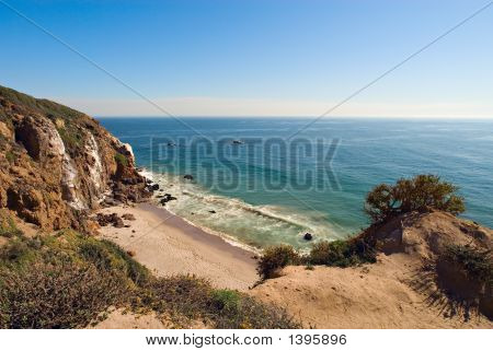 Overlooking a secluded beach at Point Dume California. poster