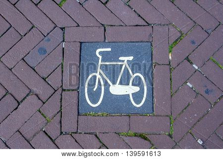 Amsterdam the Netherlands - April 13 2016: bike symbol on bike path