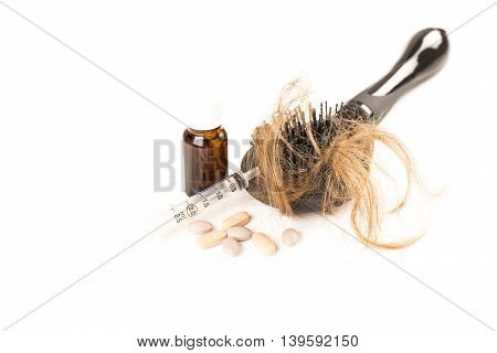 Close-up of hair loss, long hair, alopecia treatment on white background with brush