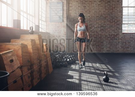 Fitness Woman Walking In The Gym