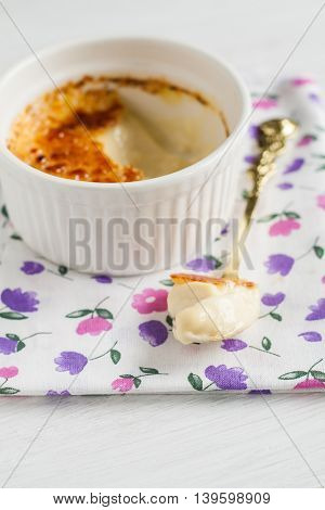 Ramekin With Creme Brulee And Spoon In The Middle