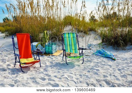 Beach Chairs with Towels and Umbrella for a day on the Beach