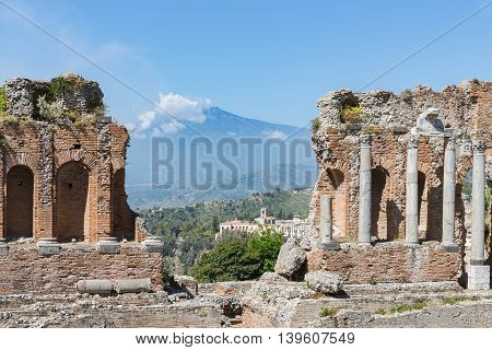Ancient Greek theater of Taormina city with a panorama at the Etna at the island Sicily Italy