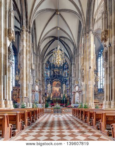 VIENNA, AUSTRIA - DECEMBER 24: St. Stephen's Cathedral interior on December 24, 2013 in Vienna. Built of limestone is 107 metres long, 40 metres wide, and 136 metres tall at its highest point.