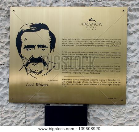 Arlamow Poland - July 18 2016: A plaque on the wall commemorating the internment of the building at this point in 1982 Lech Walesa first president of the trade union Solidarnosc the future Nobel Peace Prize laureate and President Polish