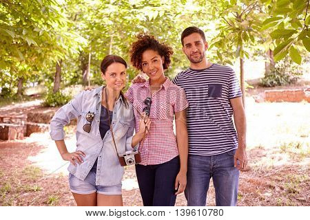 Three Young People Posing For A Photo