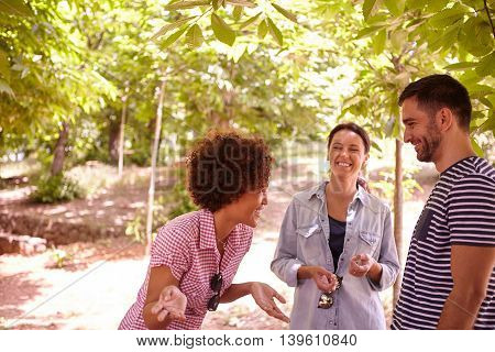 Three Happy Friends Sharing Funny Stories