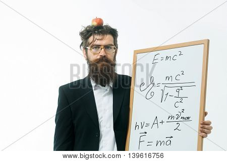 young handsome bearded man scientist or professor in glasses with long beard holding apple and teacher board with einstein formula and newtons law isolated on white background poster