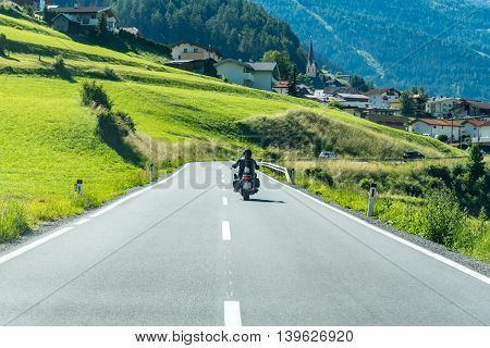 Close view on the motorbike on the route in the mountains