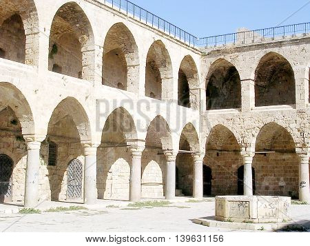 Courtyard of Khan al Omdan in old city Akko Israel