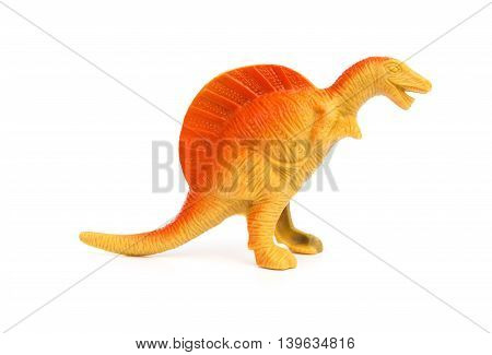 side view orange spinosaurus toy on a white background