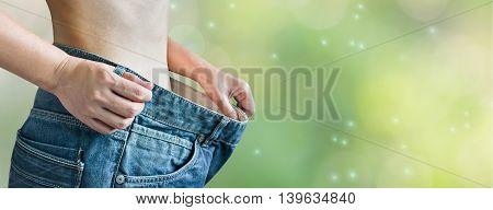 Closeup Loose Denim Jeans At Waist And Diet Women