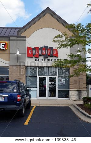 JOLIET, ILLINOIS / UNITED STATES - AUGUST 30, 2015: One may have one's hair colored at the Colorific Hair Salon, in a Joliet strip mall.