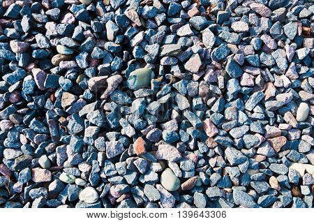 Texture colored crushed gravel with admixture of river pebbles